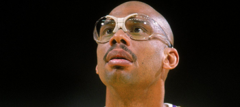 Kareem Abdul Jabbar wearing his trademark sports goggles. Image via NBA