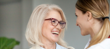 Mom wearing glasses with daughter