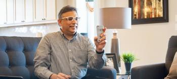 An older man using EyeQue's PDCheck pupillary distance app