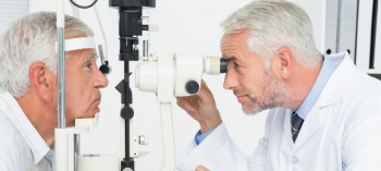 An older man being tested for cataracts