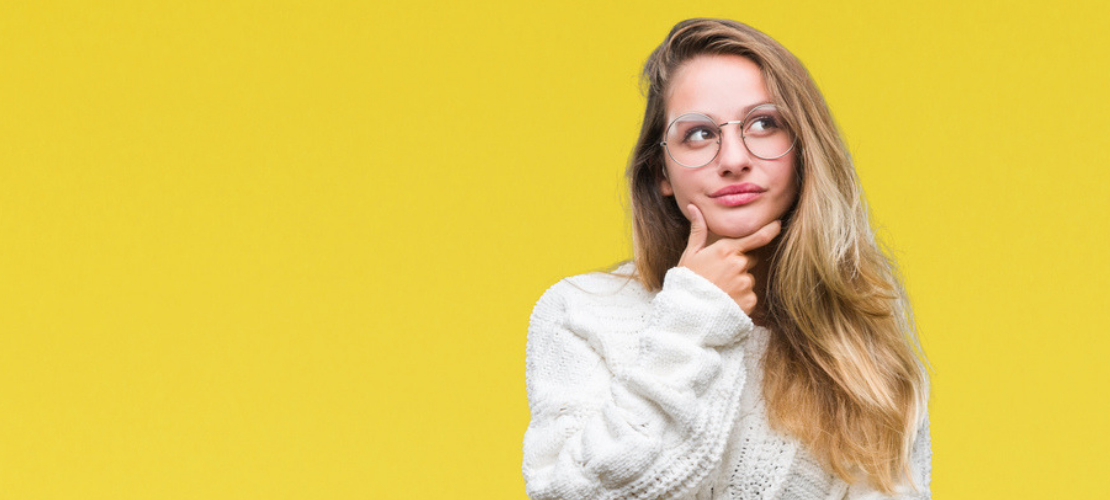 Woman Thinking With Eyeglasses