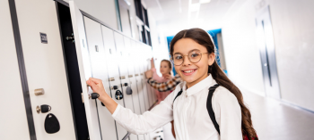 Girl with glasses near a locker at school
