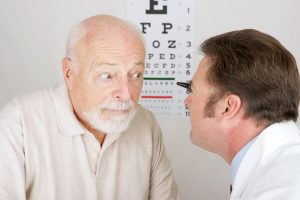 Man with cataracts during eye exam